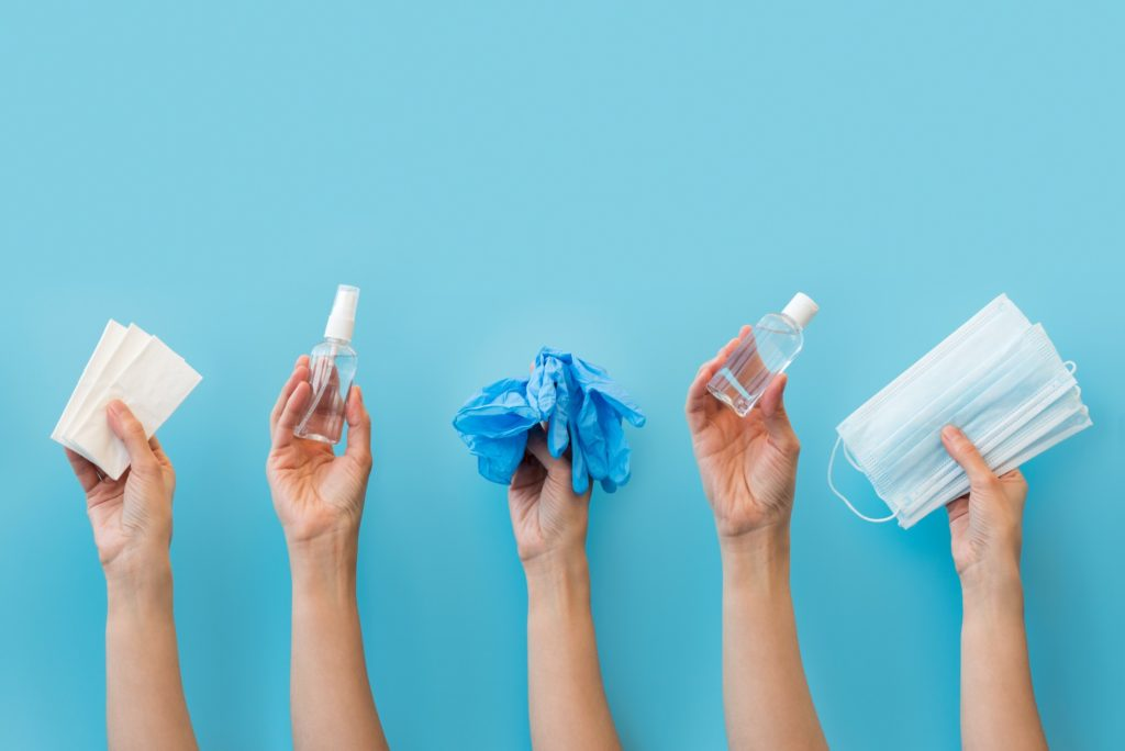 hands holding up various cleaning and protective products